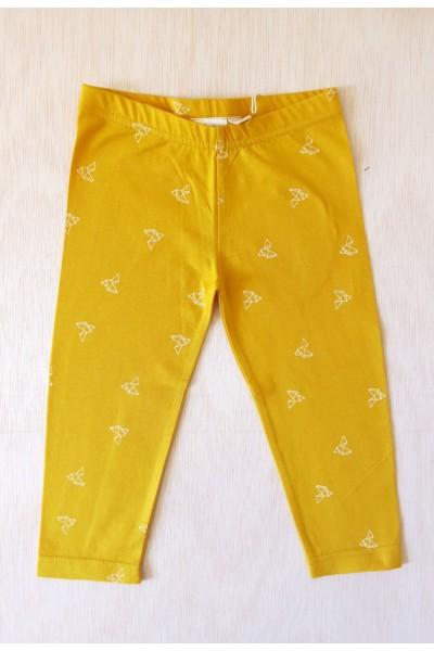 Pantalon de niño mostaza pajaros origami