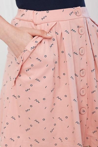 Falda botones Isa rosa estampado abstracto.